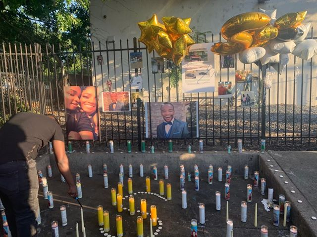 Image of roadside memorial made of candles, balloons and photos of the Steven Austin who died.