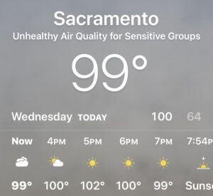 Image of weather app showing gray skies and unhealthy air quality conditions.
