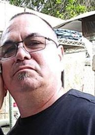 Image of man wearing glasses.