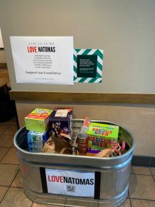 Image of galvanized metal tub full of non-perishable food items.