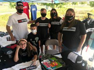Image of several people wearing LOVE NATOMAS shirts.