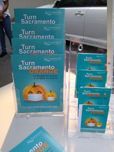 Image of brochures with pumpkins wearing facial masks.