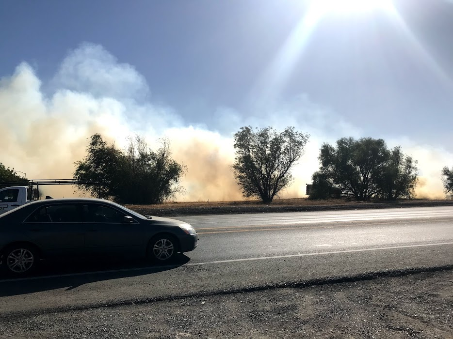 Smoke from grassfire.
