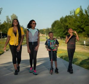 Image of two women walking on a Natomas trail with two children.
