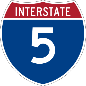 Image of Interstate 5 logo which is shaped like a shield and red, white and blue.