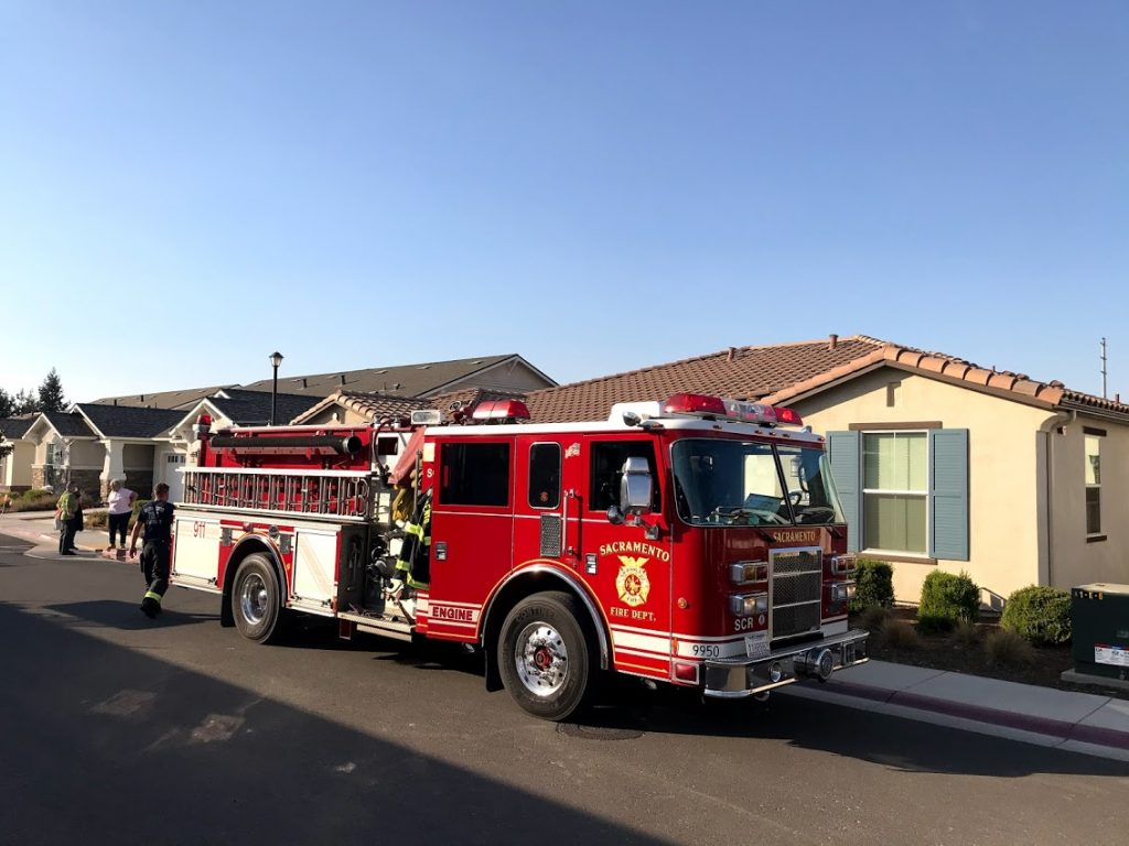 Image of fire truck in front of home.