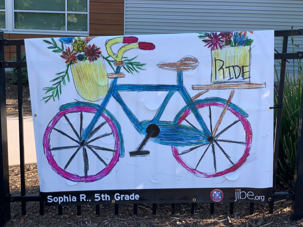 Image of banner of bicycle with basket full of flowers.