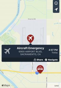 Image of airplane on map with words aircraft emergency.