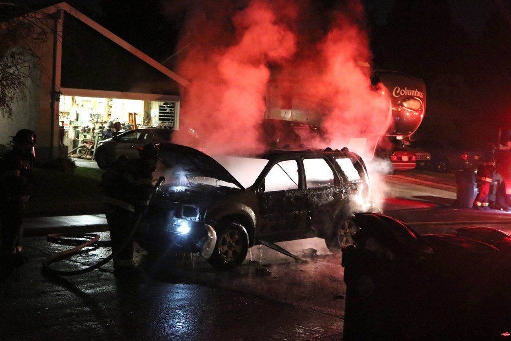 Image of vehicle engulfed in flames.