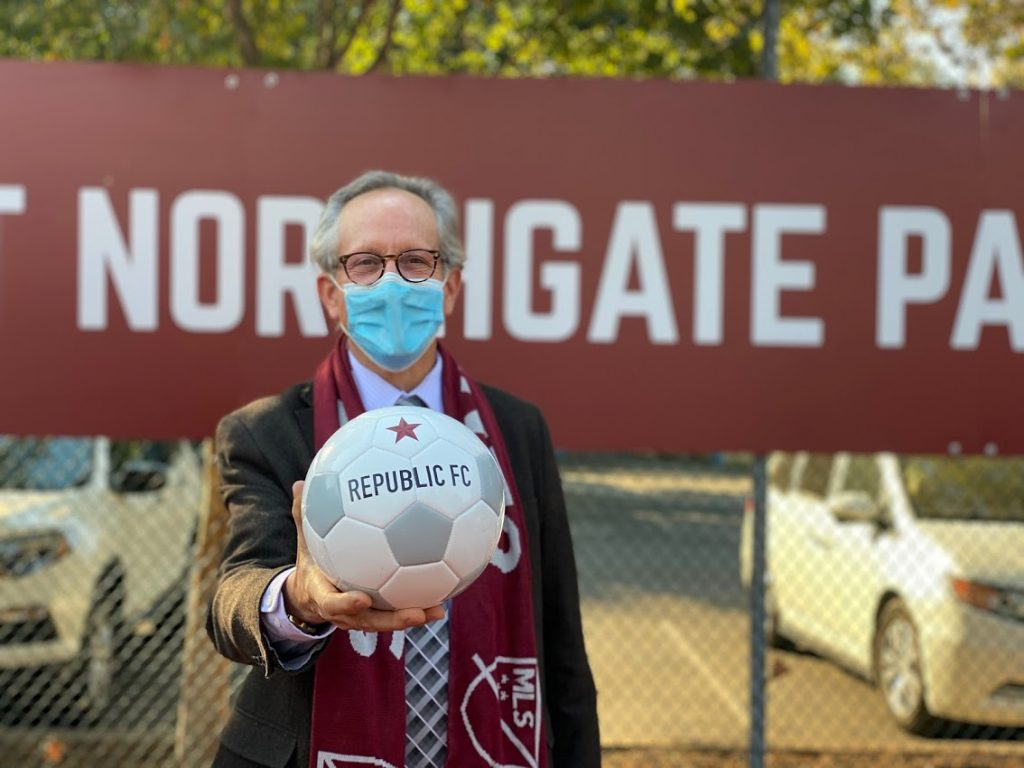 Image of Vice Mayor Jeff Harris holding out soccer ball.