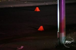 Image of orange evidence cones on the street.