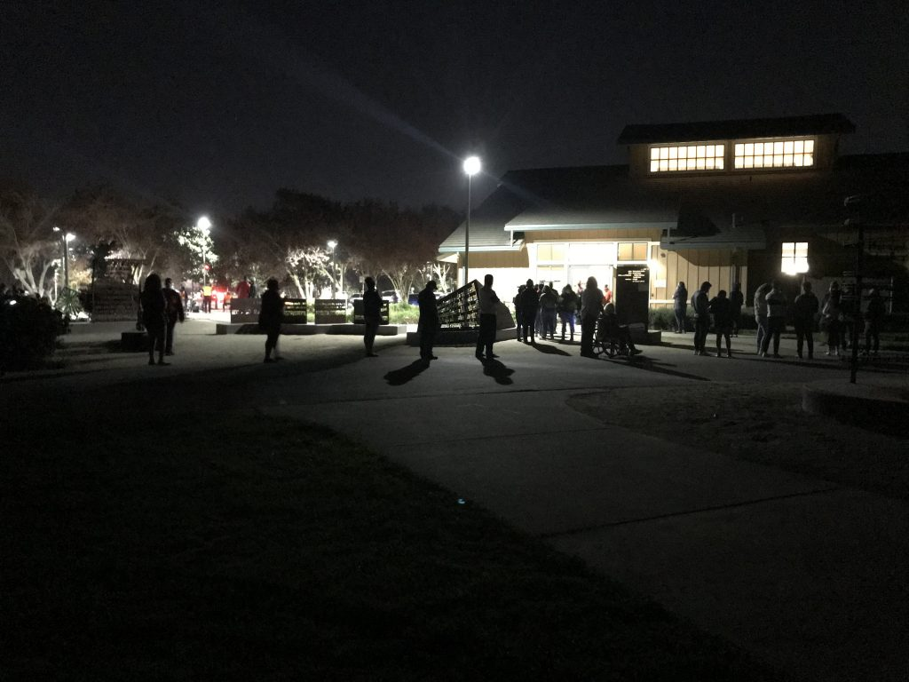 Image of silhouette of people in line on Election Day.
