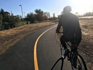 Image of rider on new Natomas bike trail.