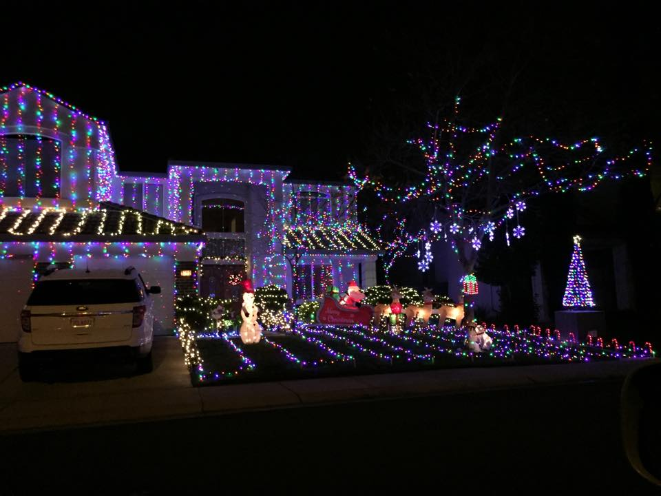 Image of house decorated with a lot of lights for the holidays..