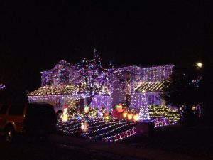 Image of house decorated with lights for the holidays.